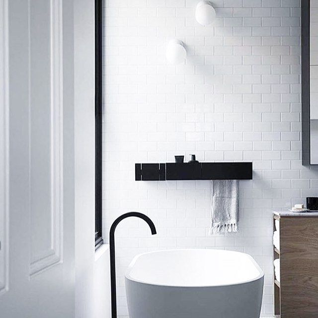 White walls. White tiles. Black accents. Absolute  Perfection. So in love with this bathroom by @whitingarchitects. Via @huntingforgeorge. Photo by @sharyncairns #bathroom #bath #contemporary #design