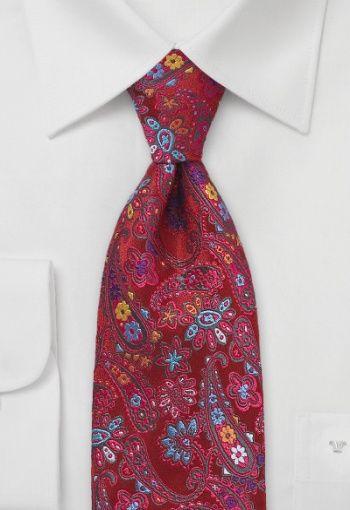 Corbata fantasía con estampado de flores en azul y amarillo sobre fondo rojo. La corbata está tejida con seda y procesada manualmente. La entretela es voluminosa y rugosa para que la corbata se alise fácilmente y permita hacer un bonito nudo. Esta corbata es de Chevalier. Las medidas: Longitud 148 cm, anchura 8,5 cm. http://www.corbata.org/corbata-flores-rojo-azul-p-14573.html