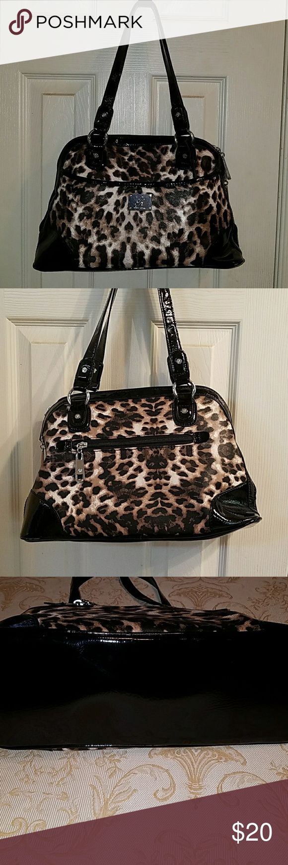 Gorgeous animal print purse by Grace Adele NWOT This is a fabulous animal print purse by Grace Adele with black patent leather trim multiple Pockets inside side pockets on both of the outer side it has no flaws it is never been carried it is in Immaculate condition with no odors Grace Adele Bags