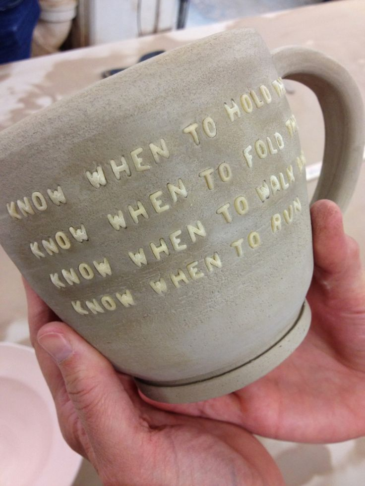 She presses the alphabet pasta into the moist clay. And burns them out in the bisque firing