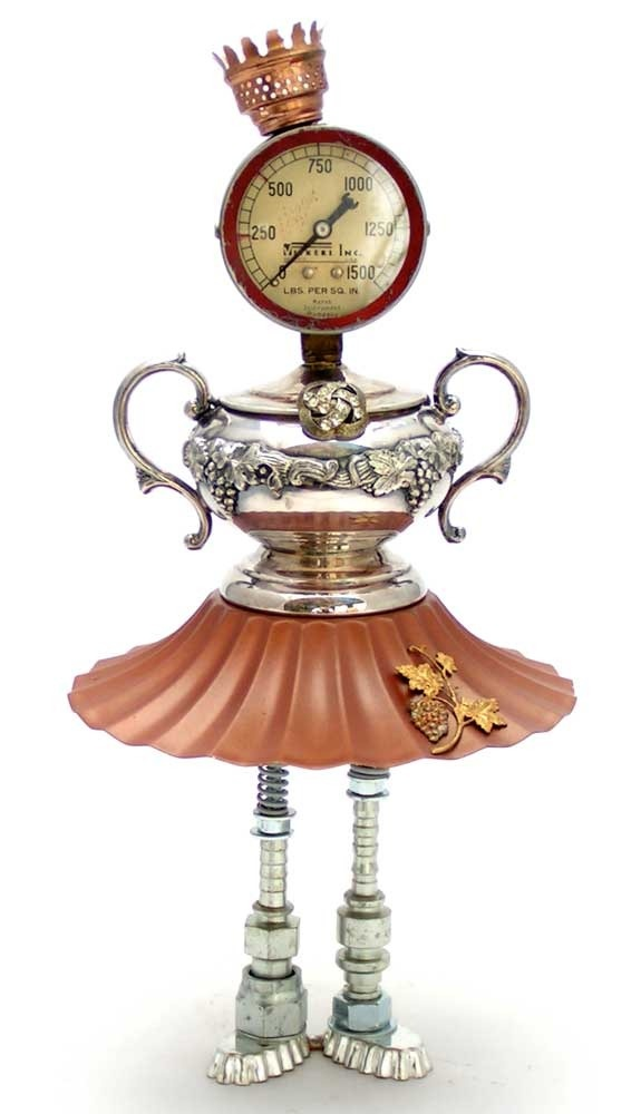 """The Lady Chablis"""" Height: 15"""" Principal Components: Pressure gauge, sugar bowl, lamp shade, petit four molds, hose fittings, oil lamp burner, button"""