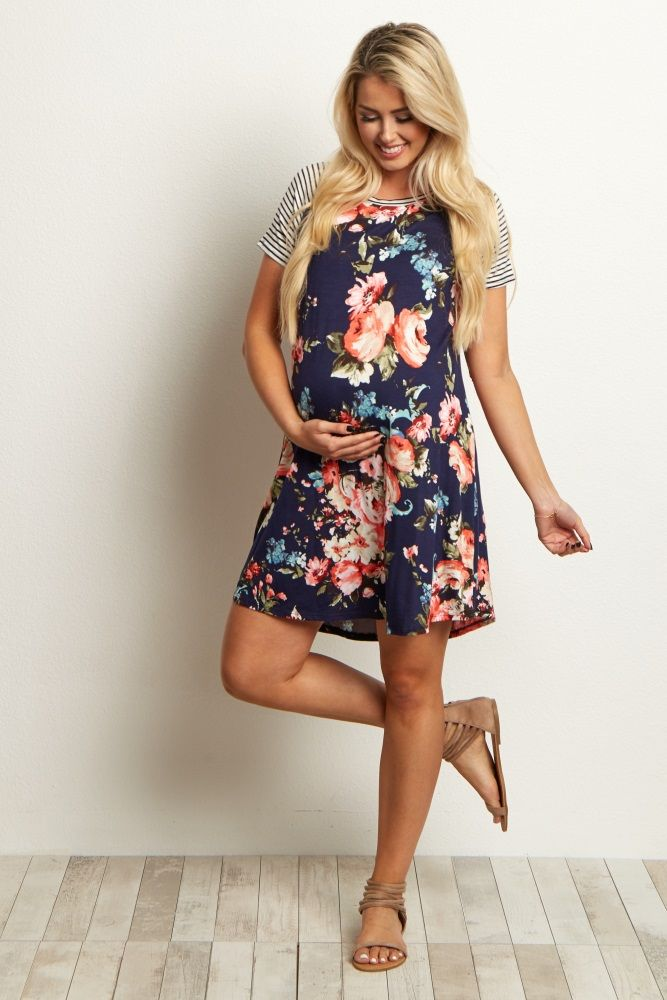 This maternity dress is nothing less than unique with its gorgeous pattern play and flowy fit. A striped shoulder accent and a floral pattern come together in beautiful harmony for a dress that can be worn day and night. Style with wedges and a long delicate necklace for a chic ensemble.
