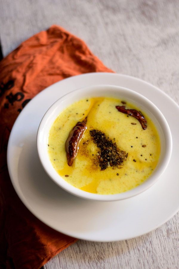 rajasthani kadhi recipe - easy and quick spiced yogurt sauce. best with steamed basmati rice or cumin rice