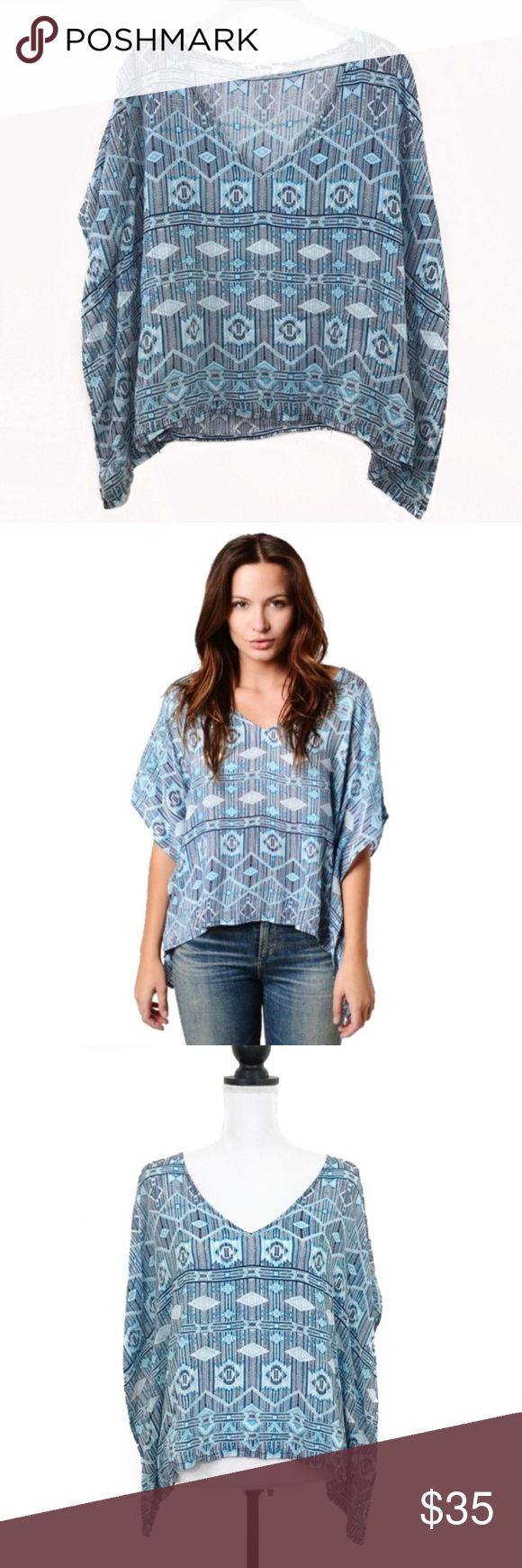 BB Dakota Blue Aztec Print 'Heath' Batwing Top Breezy and lightweight Aztec tribal printed top in shades of blue and white. V-neck with bat wing sleeves. BB Dakota Tops