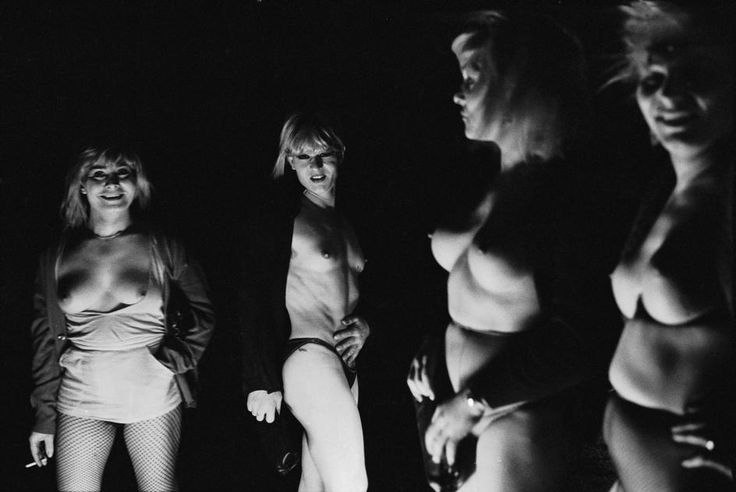 PATRICK ZACHMANN ITALY. Campania. Town of Naples. March 1982. Prostitutes and transvestites working for the camorra are warming themselves around a roadside fire