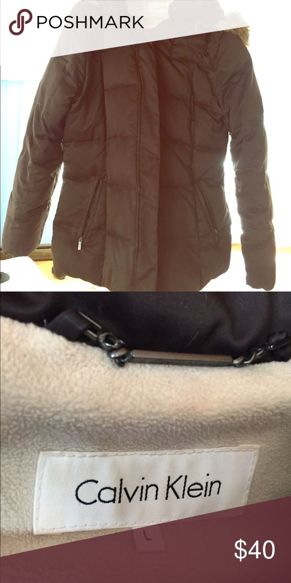 Calvin Klein puffer jacket Calvin Klein brown winter puffer jacket. This jacket is so comfortable! Fur hood two zipper pockets (one side is broken but can be fixed) Jackets & Coats Puffers