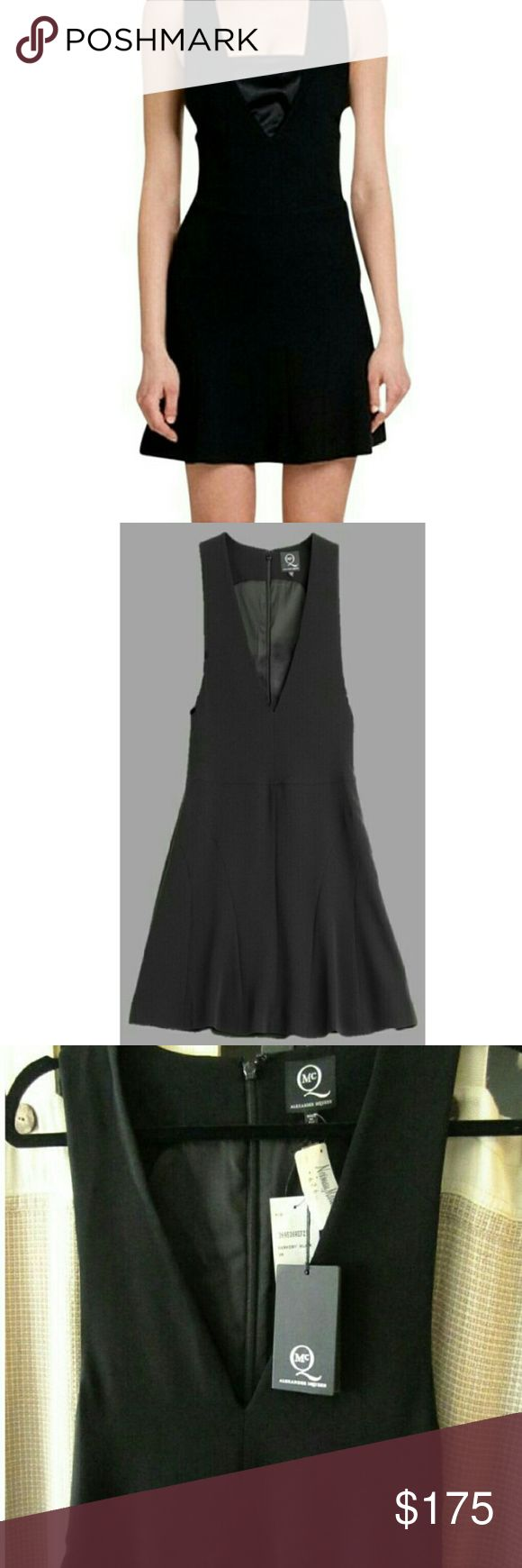 """Alexander McQueen V Neck Fit n Flair Dress New MCQ AlexanderMcQueen's black dress is fit to flatter, made modern with a daring deep v-neck and oversized armholes so you can choose to either show some major skin, or pair up with a bandeau. Perfect for adding attitude to your next social occasion, we'll be styling it with sky-high stilettos.?  Black fabric, straight neckline, zipped back. Slim fit, flared skirt.  **NOTE**dress does NOT come with bandeau insert as in photos.  Bust - 29""""…"""