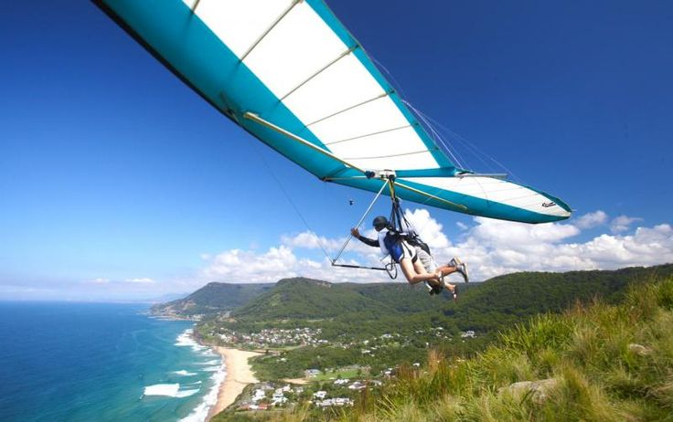 HANG-GLIDING: Experience the exhilaration of free flight with an adventure tour at Bald Hill Lookout, Stanwell Park. Hang gliding with professional pilots from the mountain to the beach...