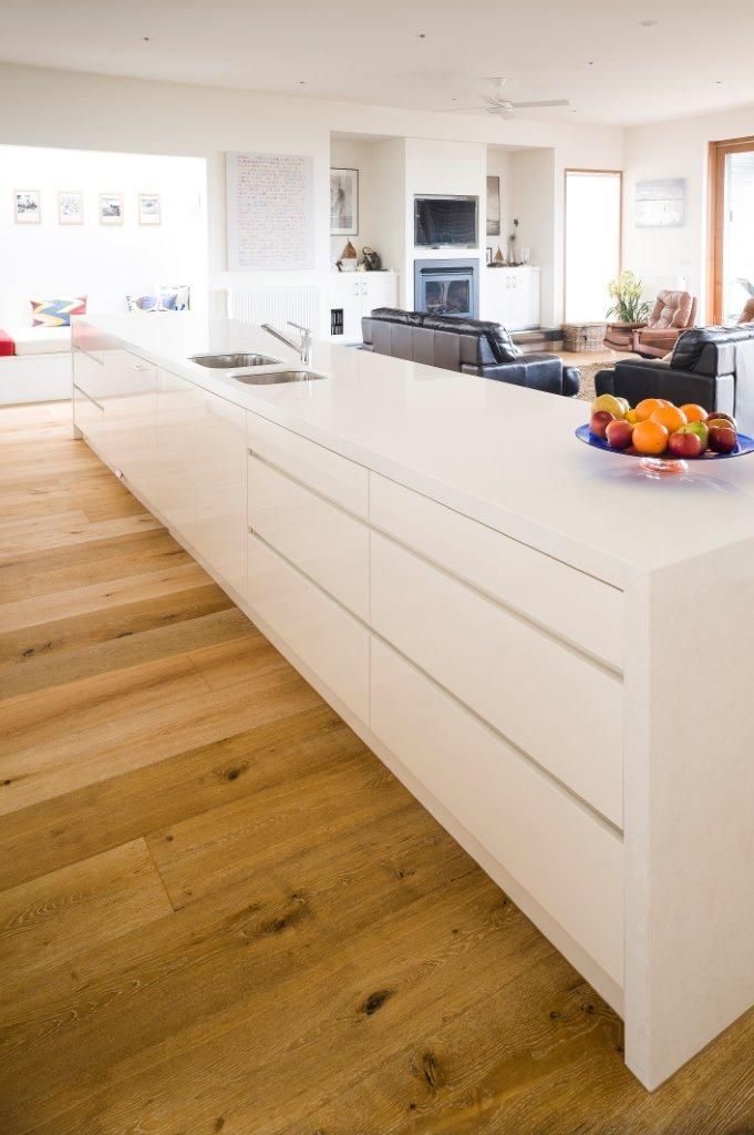 I love a plain white kitchen with natural flood boards. #white #kitchen #timber #floor