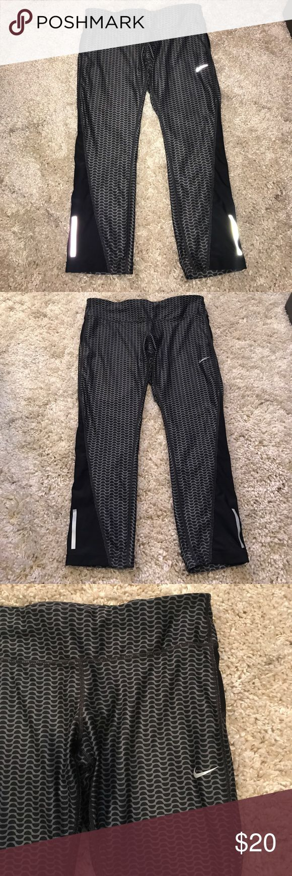Nike Dri-Fit Capri Leggings Nike Running 👟 Large + Nike Dri-Fit Running Capris + Size large | 92% polyester & 8% spandex + Grey & black design on front & back  + Super soft & comfortable + zippered pocket on the back waistband + Only selling because I re