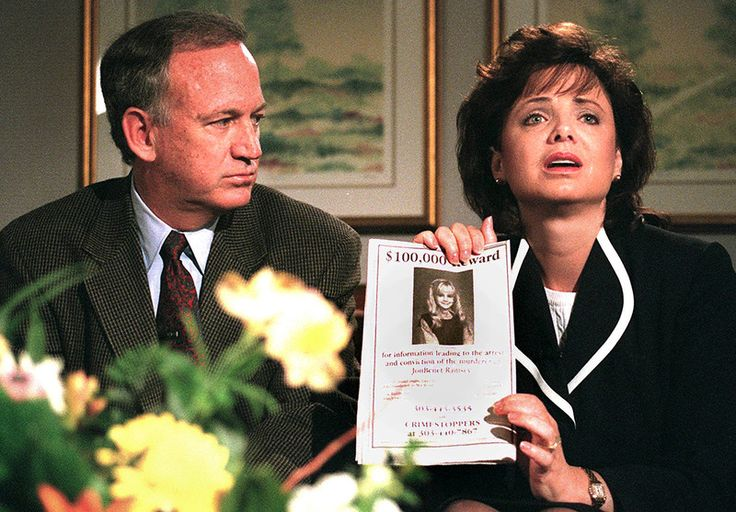 The indictment, released Oct. 2013, names John and Patsy Ramsey on two charges in JonBenet death. Pictured: John Ramsey looks on as his wife, Patsy, holds an advertisement promising a reward for information leading to the arrest and conviction of the murderer of their 6-year-old daughter, JonBenet, during an interview May 1, 1997, Boulder, CO