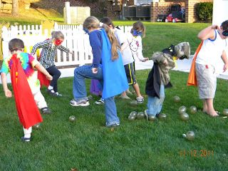 "Destroy the Bombs:  The Super Heroes must save the world by destroying the bombs. -- bombs are just blown up water balloons the kids need to stomp on to ""destroy""; then have them continue to save the world by picking up the broken balloon pieces afterward :-)"