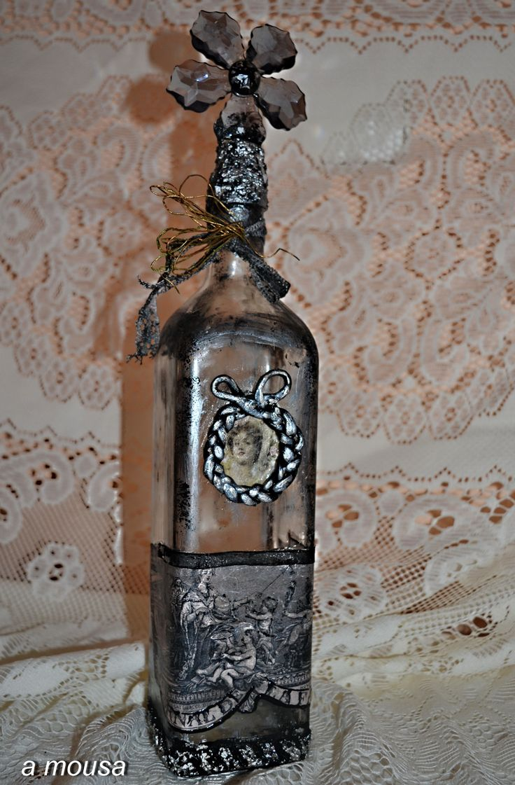 altering a bottle with modeling paste, clay, patines and decoupage!