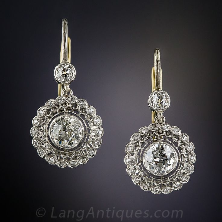 Edwardian Style Diamond Drop Earrings. A sparkling pair of European-cut diamonds, totaling 1 carat, float inside light and lacy circles of delicate honeycombed filigree outlined with tiny glittering round diamonds. These gorgeous and versatile ear drops are expertly crafted in platinum with 18K lever backs in enduring feminine Edwardian style.