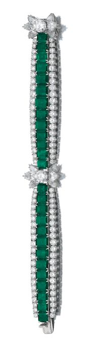 EMERALD AND DIAMOND BRACELET, HARRY WINSTON, 1960S Designed as a graduated line of step-cut emeralds, framed on either side with rows of circular-cut diamonds, highlighted with clusters of pear-shaped and circular-cut diamonds, length approximately 180mm, signed Winston and numbered, case stamped Harry Winston.