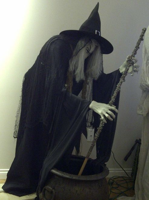 """Stirring witch - pvc frame, foam body.  There's a mechanism in the caouldron that makes her """"stir"""""""