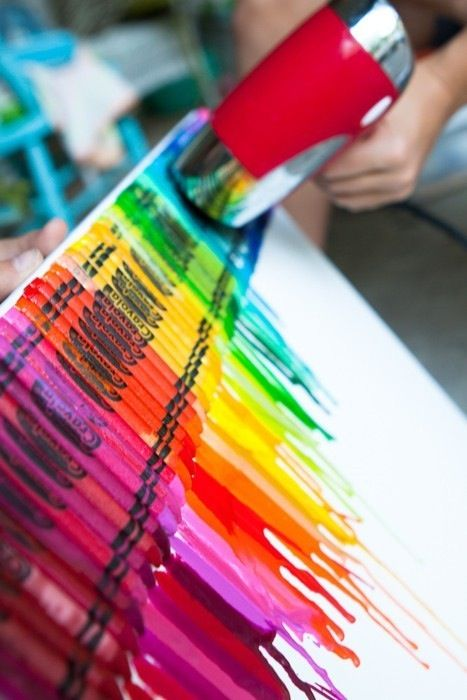 Hold a hair dryer against crayons that you glued on a canvas and watch yourself make crayon art