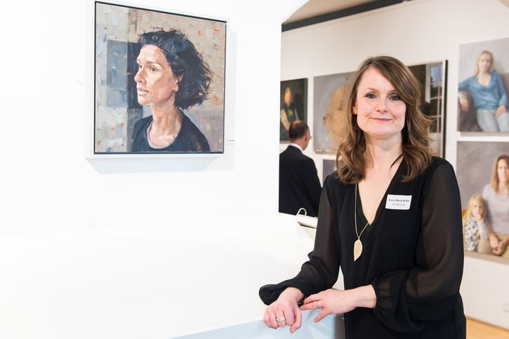 Anne-Marie Butlin poses next to her portrait of Indira Varma at the Royal Society of Portrait Painters Photocall at the Mall Galleries on May 4, 2016 in London, England.  (Photo by Ian Gavan/Getty Images)…
