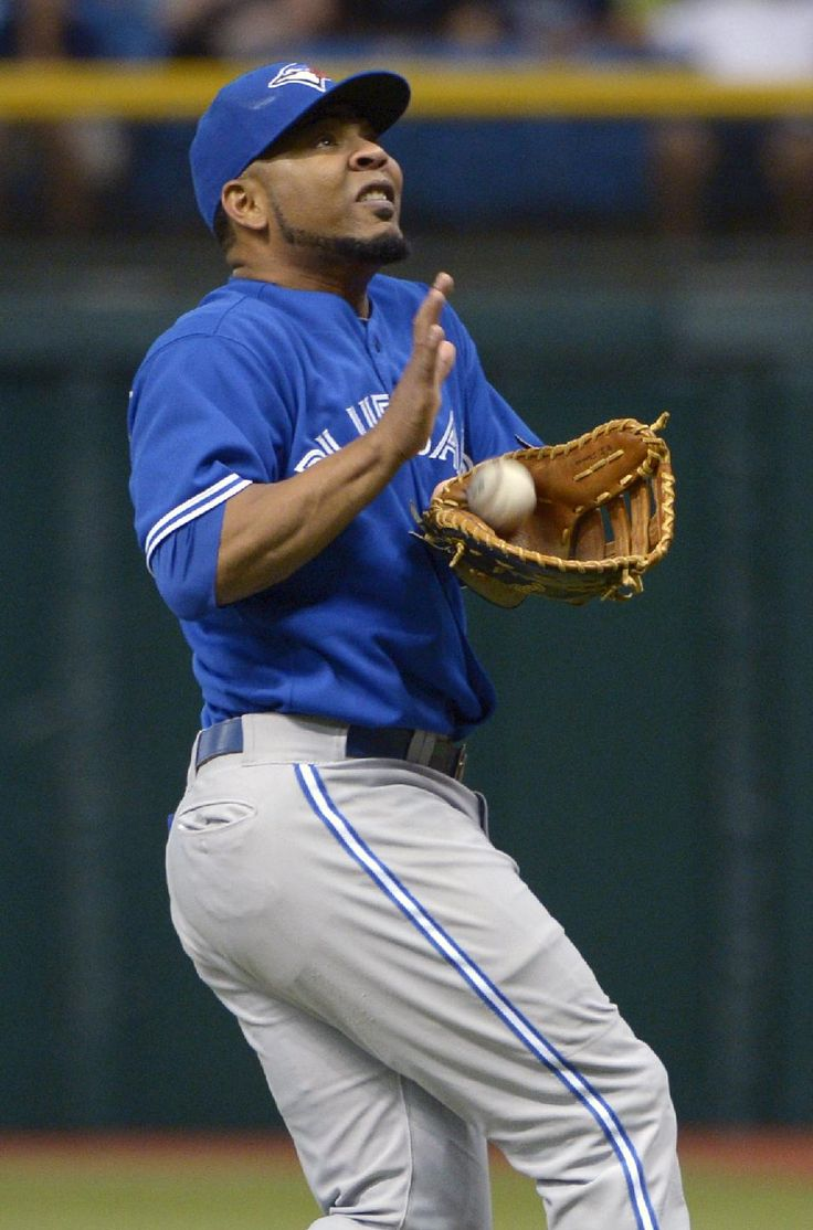 Toronto Blue Jays first baseman Edwin Encarnacion catches a foul pop fly for an out from Tampa Bay Rays' Jason Bourgeois during the first inning of a baseball game in St. Petersburg, Fla., Saturday, Aug. 17, 2013.(AP Photo/Phelan M. Ebenhack)
