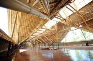 BAMBOO ARCHITECTURE on Bali - A general view a a roof of a chocolate factory constructed from bamboo at a village in Sibang, Badung regency on Bali island in this photograph taken on June 4, 201. Strong, light and cheaper than steel, bamboo is ubiquitous across Asia as scaffolding. But the Indonesian island of Bali has made it an emblem of sustainable construction with a school, luxury villas and even a chocolate factory rising from bamboo skeletons. (AFP Photo/Sonny Tumbelaka)