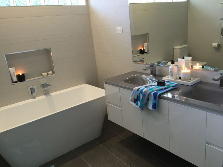 This full bathroom renovation transformed the room into a modern masterpiece. Great interior design with all the latest bathroom products from Highgrove Bathrooms. Freestanding bath an modern wall hung vanity with glass top and state of the art basin mixers