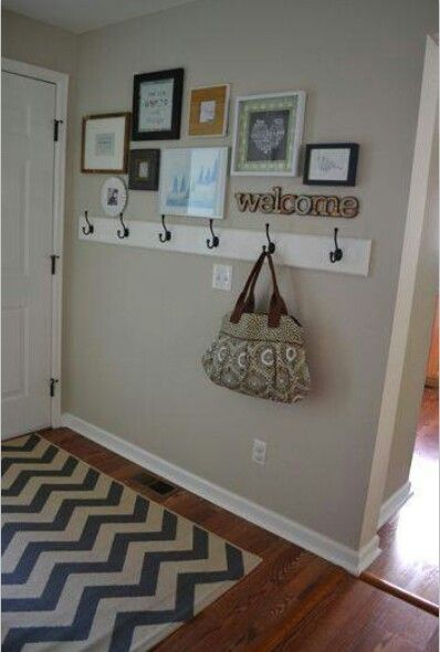 Doing this but would love to switch out the hooks for old hardware like cabinet pulls or something rustic