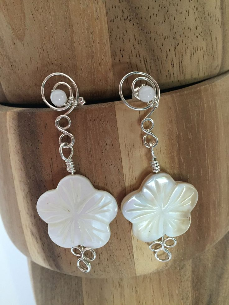 A personal favourite from my Etsy shop https://www.etsy.com/au/listing/244366232/white-mother-of-pearl-flower-earrings