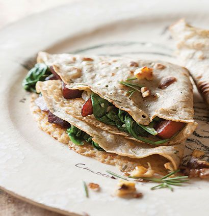 Rosemary buckwheat pancakes with wilted spinach, butternut and apple