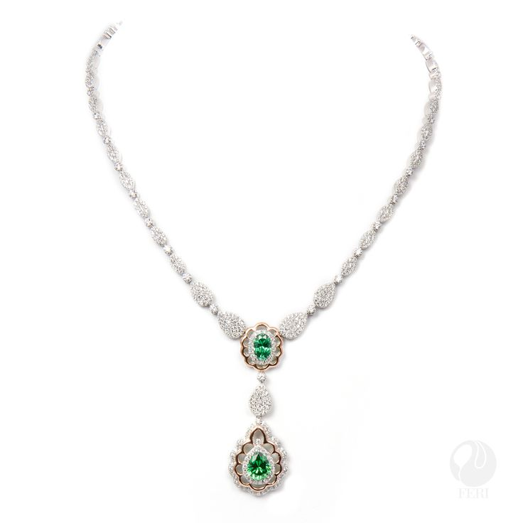 "FERI - When We Met - Necklace - Exclusive FERI 950 Siledium silver - Exclusive dual natural rhodium and palladium plating - Set with exclusive FERI Swan cut lab stones - Colour: white and an emerald colour - Rose coloured gold plating accent - Dimension: 16"" length, 4"" extender with lobster clasp  Invest with confidence in FERI Designer Lines.   www.gwtcorp.com/ghem or email fashionforghem.com for big discount"