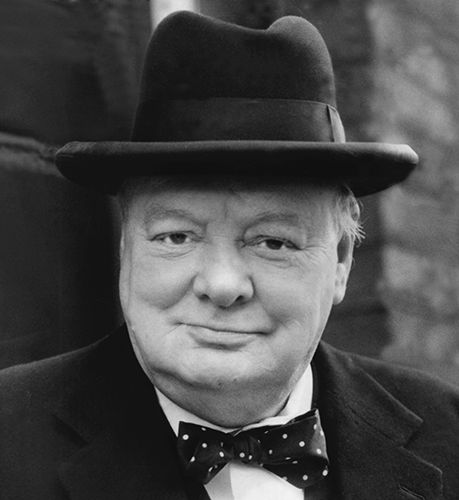 Winston Churchill in his trademark hat and bow tie. Credit: David Cole/Alamy