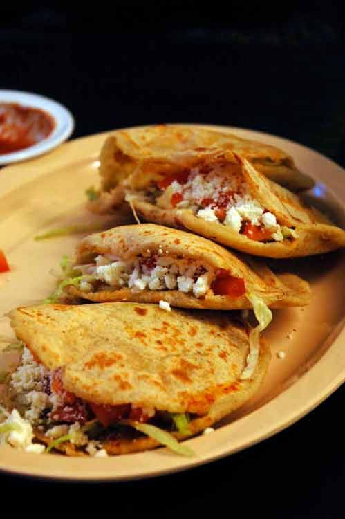 "Gorditas de Chicharron: these are what real ""gorditas"" look like (not the fake Taco Bell stuff).  Made from Maseca, fried or cooked on a grill, fill them up with whatever you like and make them chubby. Hence the name!"