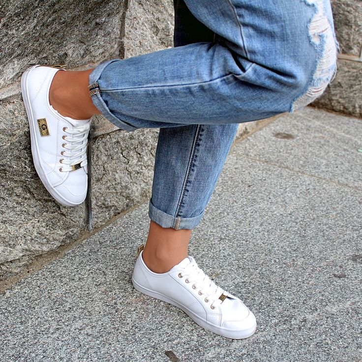 White guess sneakers with gold details