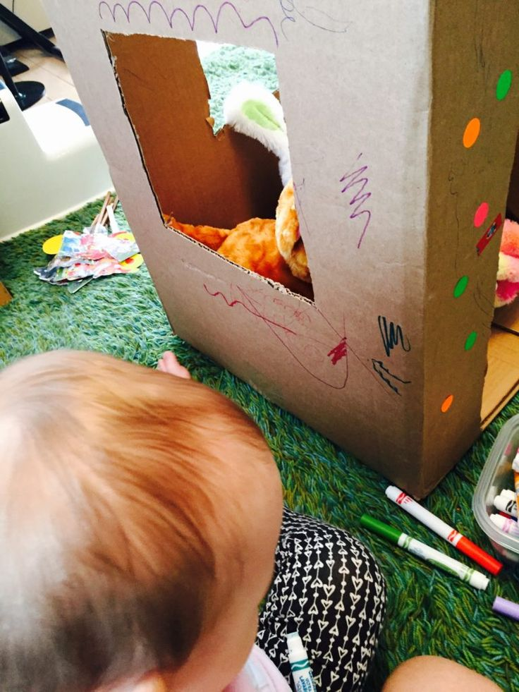 Cardboard house 6 play ideas, activities for one year old, development promoting activities for toddlers, toddler games, activities for 12 month old, activities for 13 month old, activities for 14 month old, activities for 15 month old, activities for 16