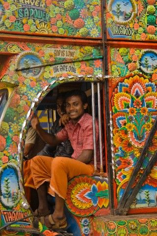 People in colorfully decorated tuk tuk during Onam Festival, Thrissur, Kerala State, India