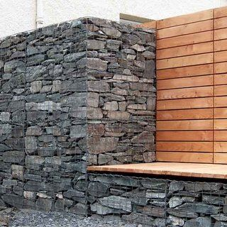Gabion (that's a wire cage filled with stones) wall for the garden