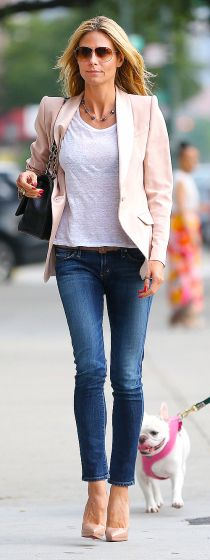 Heidi Klum is all smiles as she goes for a stroll in the West Village in a pink blazer