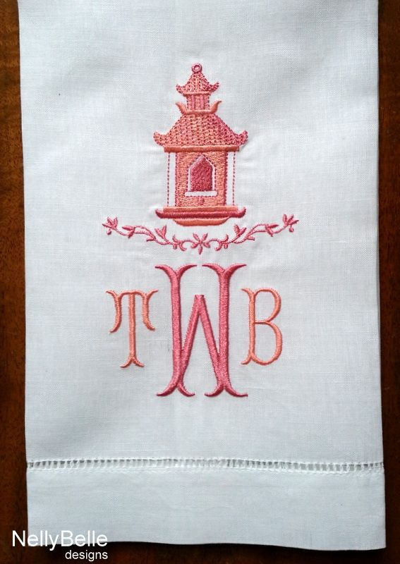 Chinoiserie pagoda monogram embroidered in shades of coral