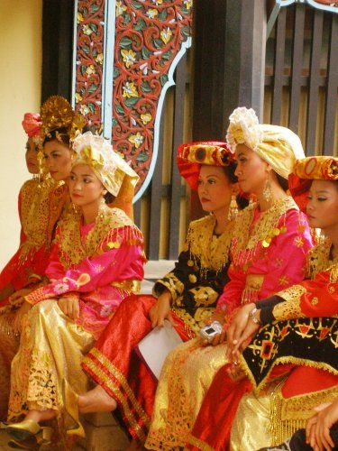 Wearing traditional Minang [or Minangkabau] costumes, these girls are waiting for their turn to perform in a carnival. Women control every aspect of family life among the community. Minang ethnic group originates from the part of west coast of Indonesia's third largest island -- Sumatra.