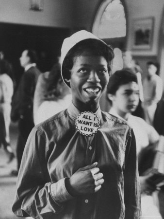 """Gordon Parks is a really interesting photographer, he takes pictures of ghetto, run down areas and gives the viewers a look into their life. Like this picture """"All I Want Is Love"""". I think it speaks so much to the discrimination that blacks faced for so long."""