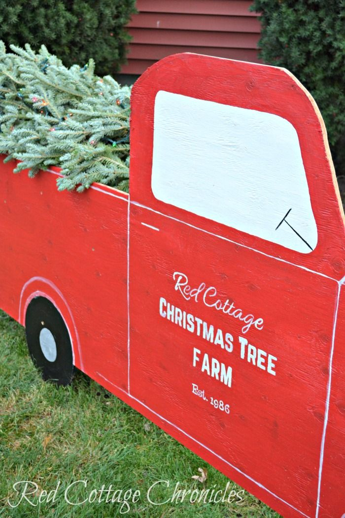 Wanting to dress up the outdoor Christmas decorations a bit this year, we decided to make a huge DIY red truck and Christmas tree for the yard!
