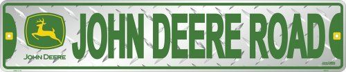 "John Deere Street Road, Embossed Diamond Design by John Deere. $11.98. Embossed and painted metal sign. Quality aluminum construction. Made in usa. John Deere metal street sign reads ""John Deere Road"". Silver with green and yellow embossed design. Measures 24in x 5 in."