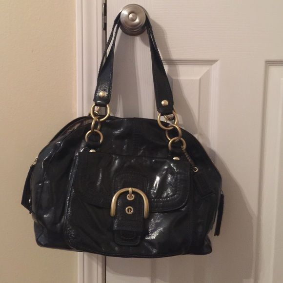 Authentic Black Coach Purse Authentic black leather coach purse with gold accents. Inside and outside are in great condition. Used for approximately six months. Coach Bags Satchels