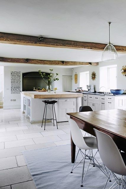 A Modern Country Kitchen With White Wooden Units U0026 Island, Dark Limestone  Floor, Range