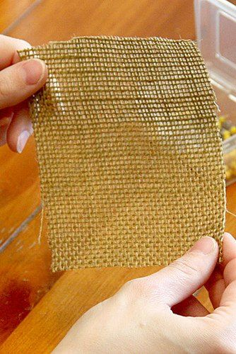 Next time you're at Hobby Lobby, grab some burlap and make this idea to brighten up your front door!