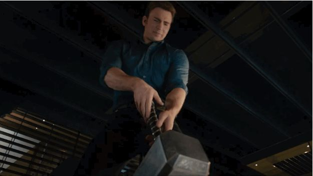 "Next up, Steve Rogers, aka Captain America (Chris Evans), tries to lift Thor's hammer. | The Avengers Play With Thor's Hammer In New ""Age Of Ultron"" Clip"