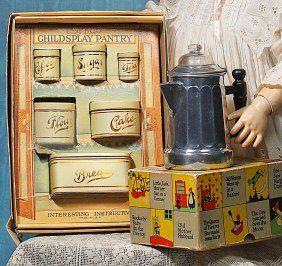 ANTIQUE TINS, CHILD'S BOXED PANTRY SET, AND COFFEE MAKER.