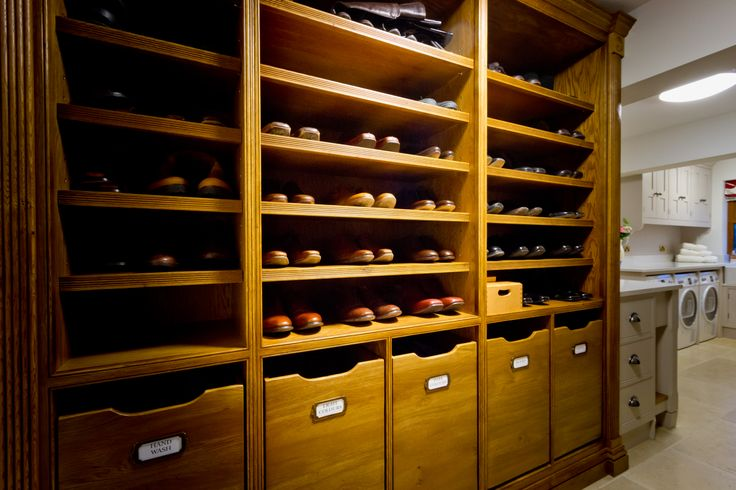 Stunning bespoke shelving houses numerous pairs of shoes and the drawer baskets underneath provide a neat way of housing dirty laundry