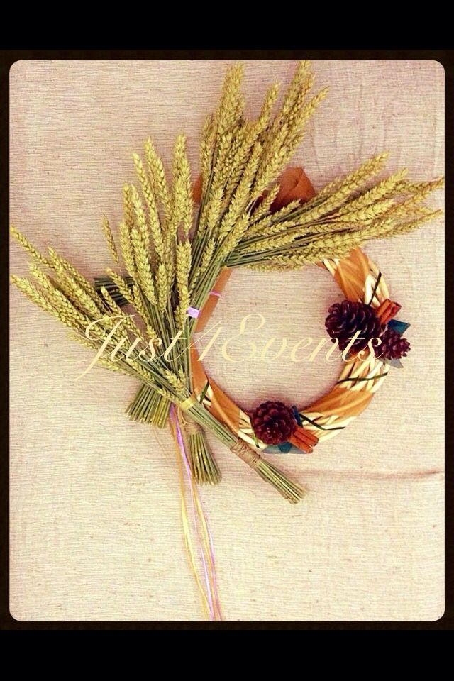 Wreath of flowers!!!!! Ears, cones, cinnamon and ribbons make it appear perfect!