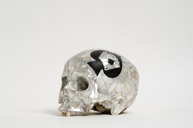 Human skull, mother of pearl, black marble and jasper. By Alastair Mackie.