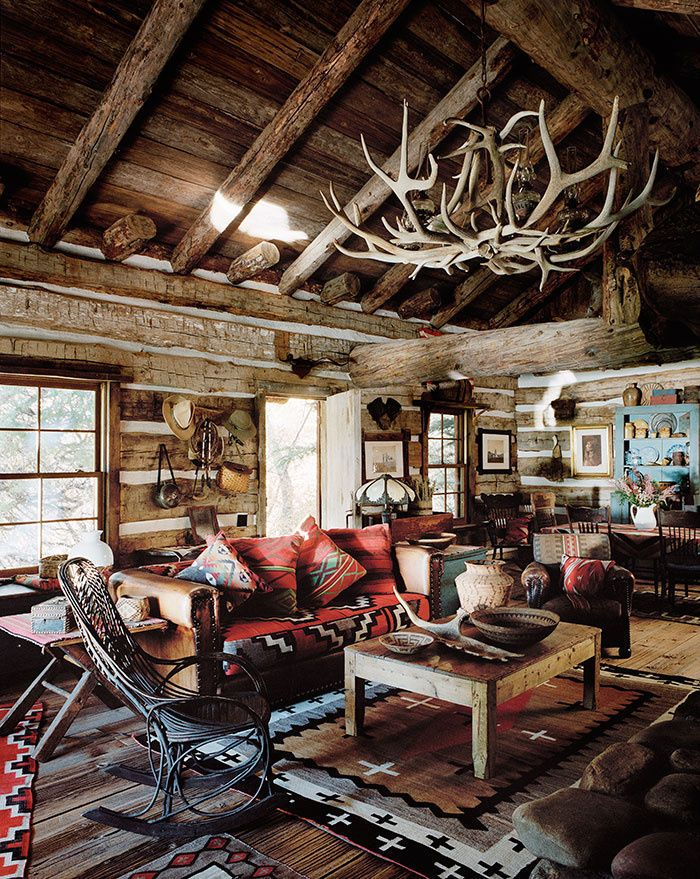 6 cozy cabins that will inspire a winter getaway - Cabin Living Room Decor